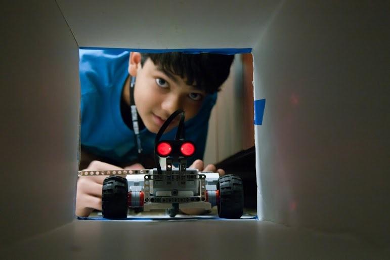robotics student tests robots using obstacles